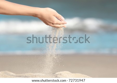 Sifting sand through hands