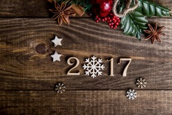 Sigh symbol from number 2017 on vintage style wooden texture background. Happy New Year 2017 greetings on wooden. snowflake wood. Empty space for your text. instead of zero snowflake
