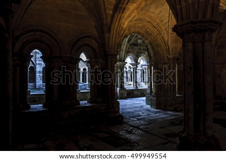 sight of the galleries of the cloister with arches, props and columns of the Romanesque abbey of Santa Maria the Real one in aguilar of Campoo, Palencia, Spain Сток-фото ©