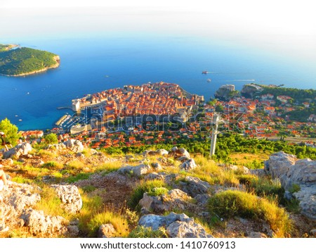 Sightseeing of Dubrovnik at sunset. Adriatic sea and Dubrovnik Old Town panorama from the Kriz (Huge stone mountaintop cross) viewpoint in Dalmatia, Croatia. Stok fotoğraf ©