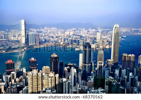 Sightseeing of the skyline, forest of skyscrapers and building on the Victoria Harbor in Hong Kong on clear sunny day from above. - stock photo