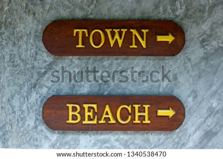 sightseeing posts town and beach in a touristic resort