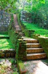Sigiriya ( Lion's rock ) is a large stone and ancient palace ruin in the central  Sri Lanka ( Ceylon ). steps and the ruins of the royal palace and the park of Sigiriya