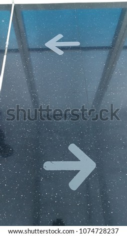 Sign and symbol : Arrow signs on the floor showing way to go in and out #1074728237