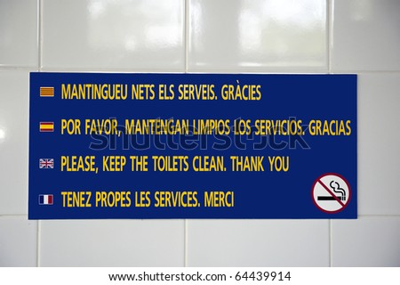 Sign at camping toilets in French,English,Spanish and Catalan with text: Please, keep the toilets clean.Thank you