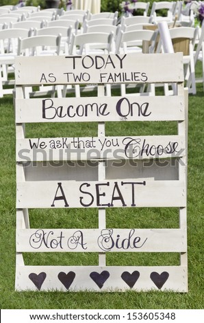 """Sign at outdoor wedding: """"Today as two families become one we ask that you choose a seat not a side"""""""
