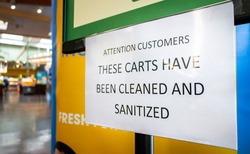 Sign at store stating Carts Have Been Cleaned And Santitized