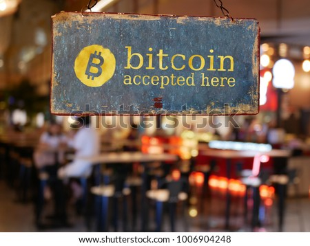 sign bitcoin accepted here hanging in front of restaurant door. bitcoin , electronic money concept #1006904248