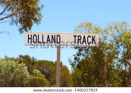 Sign board of Holland Track, unpaved 4wd road adventure from Broomehill to Coolgardie, Western Australia #1400257859