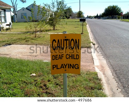 Sign: CAUTION, deaf child playing.