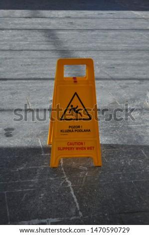 "Sign ""Caution! Slippery floor!"" inscription in Czech"