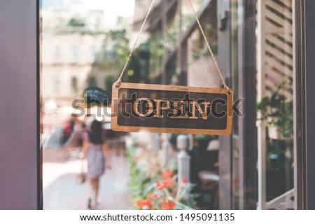sign come in open on the door of the restaurant. open signboard  Сток-фото ©