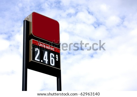 sign displaying gas pricing at a service station