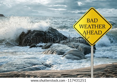 Sign for bad weather with roughs sea, waves and stormy clouds in the background