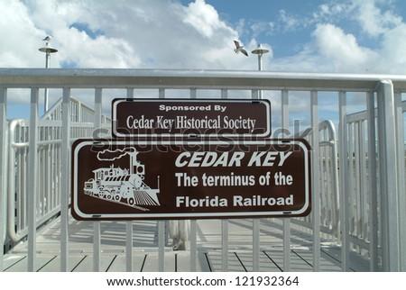 sign for cedar key pier on the...
