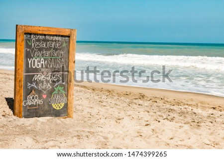 Sign for massage, yoga and accommodation at a beach in Palomino in Colombia #1474399265