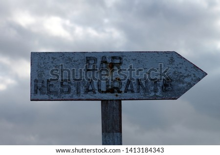 Sign for the restaurant, wooden sign