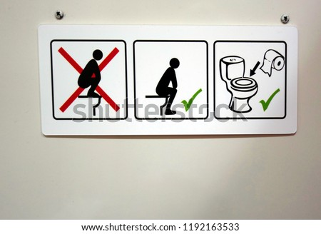 Sign giving toileting instructions           #1192163533