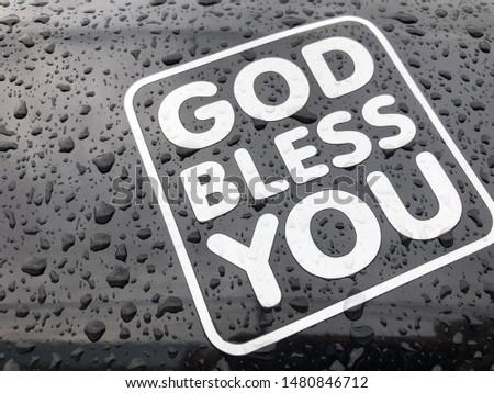 Sign God bless you on black blackground