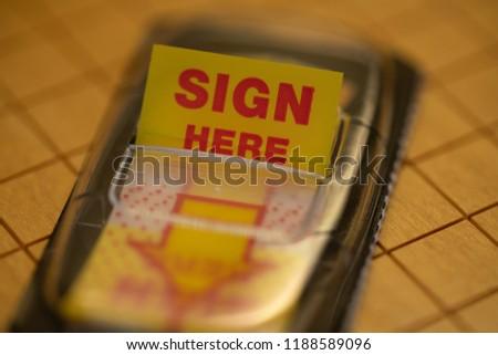 Sign here sticker #1188589096