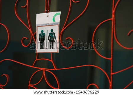 Sign icon, Pictogram female and male toilet in plastic bag. #1543696229
