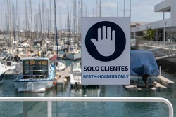 sign in marina dock for boats for customers only, Lanzarote Island