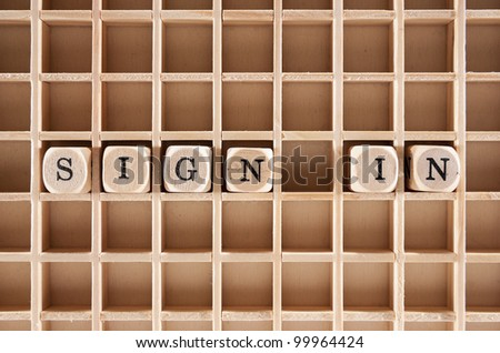 Sign-in word construction with letter blocks / cubes and a shallow depth of field