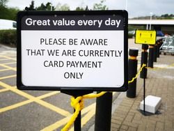 Sign informing customers of Card Payment Only and No Cash Purchases allowed - for safety and self distancing as shops re-open during the COVID-19 Pandemic in UK
