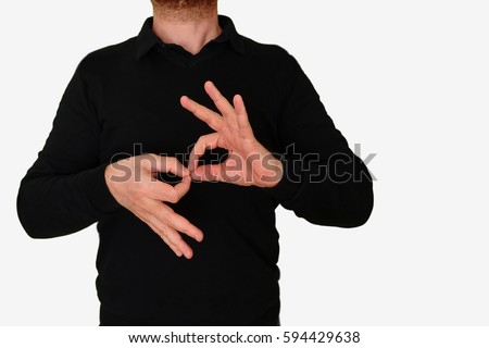 Sign language interpreter man translating a meeting to ASL, American Sign Language. Empty copy space for Editor's content.