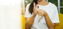 Sign language learning concepts : Young woman teaches basic sign language skills for easy understanding. : Copy Space