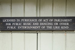 Sign licencing premises for public music and dancing and other public entertainment