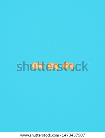 Sign - Minus from cookies in the shape of fish on a blue background #1473437507