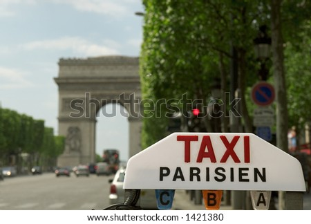Sign of a parisian taxi on the Champs-Elysees.
