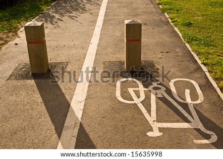 Sign of cycling path. The way is blocked for cars.