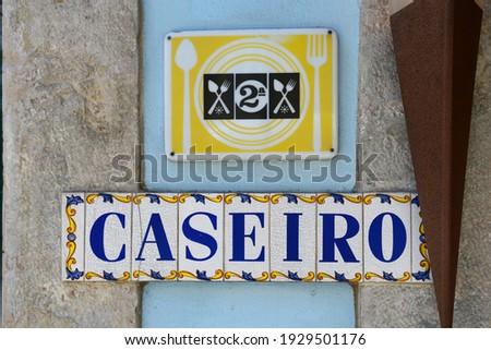 Sign of Historic Caseiro building at Rua de Belem 35 at Tv. das Linheiras in Belem district in city of Lisbon, Portugal.  Foto stock ©