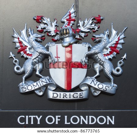 Sign of the city of London with dragons and shield - stock photo