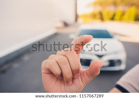 sign of the heart, love of the new car, transparent glass in the shape of a heart on the background machine #1157067289
