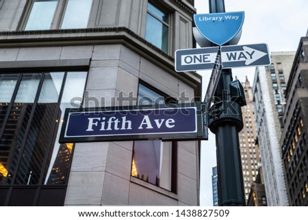 Sign of the 5th Avenue (Fifth Avenue) with modern skyscrapers in Manhattan, New York City, USA #1438827509