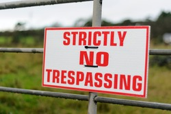 Sign on a farm gate warning