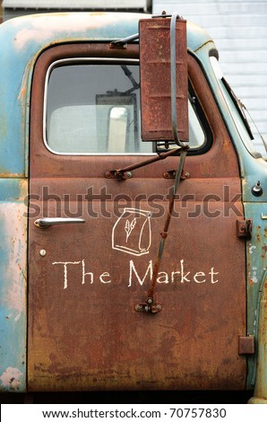 Sign on a truck outside a farmers market in McMinnville Oregon