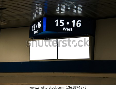 Sign on a wall near the ceiling Top part shows track numbers and the two screens below are blank copy space