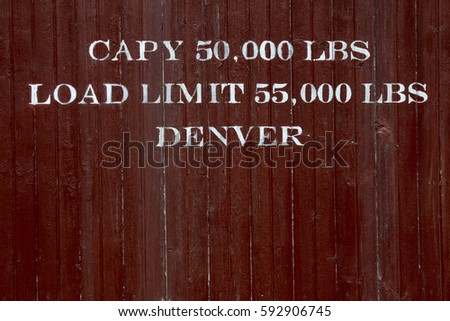 Sign on an antique train car describing the capacity and load limits
