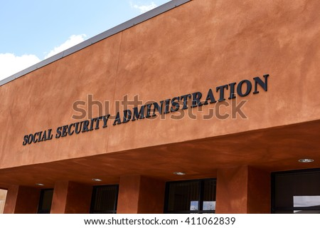 Sign on front of government building reading Social Security Administration #411062839