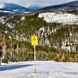 sign on ski hill warning of icy conditions