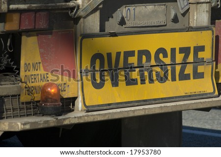 sign on the back of an oversize truck, metaphor of obese
