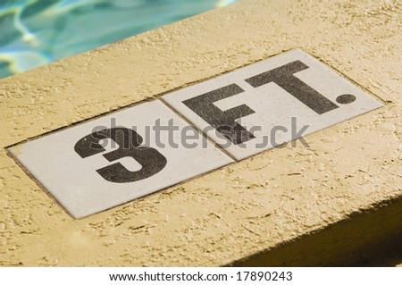 sign on the side of pool - stock photo