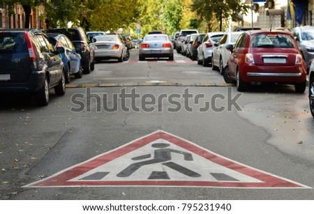 sign pedestrian crossing drawn on asphalt  #795231940