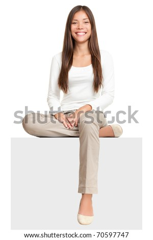 Sign people. Woman sitting on blank billboard placard sign. Casual young beautiful multiracial Asian isolated on white background. Foto d'archivio ©