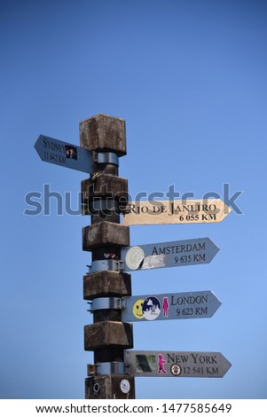 Sign post indicating directions and distance to New York, Sydney, London, Amsterdam and Rio de Janeiro at Cape of Good Hope #1477585649