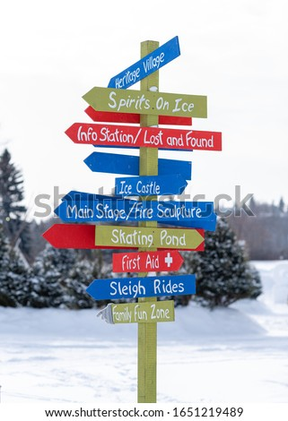 Sign post with many colored signs. Winter fun activities. Colourful.